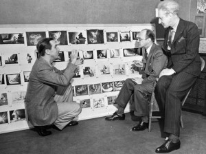 That's Walt Disney at a storyboard briefing team members of a project.